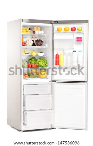 Open fridge full of healthy food products isolated on white background - stock photo
