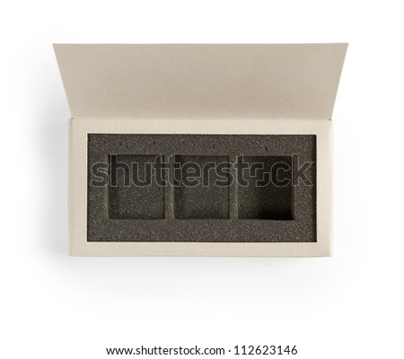 Open gift box. A box with lid open, with inner foam cushion separated in  three sections. Isolated on white. - stock photo