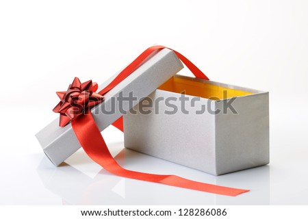 open gift box with bow and red ribbon on white background - stock photo