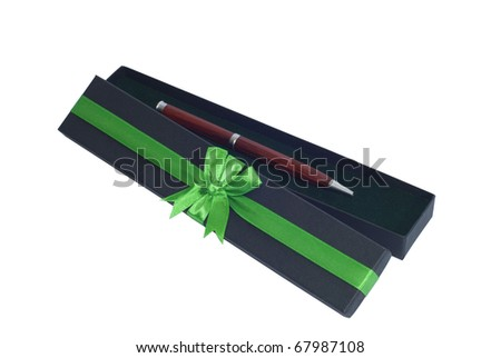 Open giftbox with a green ribbon. It contains a wooden ballpen - stock photo