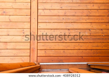 Open glass door leading onto wooden deck or porch from straight above with rich warm wood grain textures and colors - stock photo
