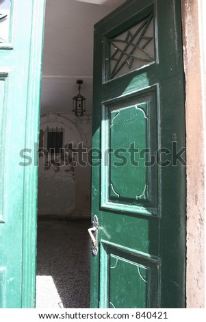 Open green door in Dubrovnik, Croatia. - stock photo