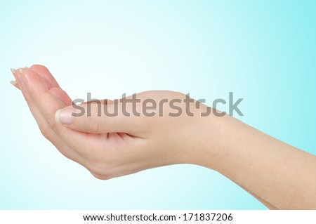 Open hand on blue background