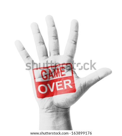 Open hand raised, Game Over sign painted, multi purpose concept - isolated on white background - stock photo