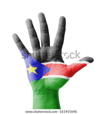 Open hand raised, multi purpose concept, South Sudan flag painted - isolated on white background