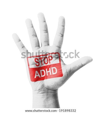 Open hand raised, Stop ADHD (Attention deficit hyperactivity disorder) sign painted, multi purpose concept - isolated on white background - stock photo