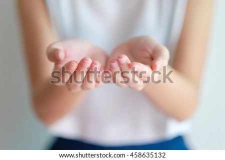 open hands of woman sign of begging,giving,holding with blurry background on her  - stock photo