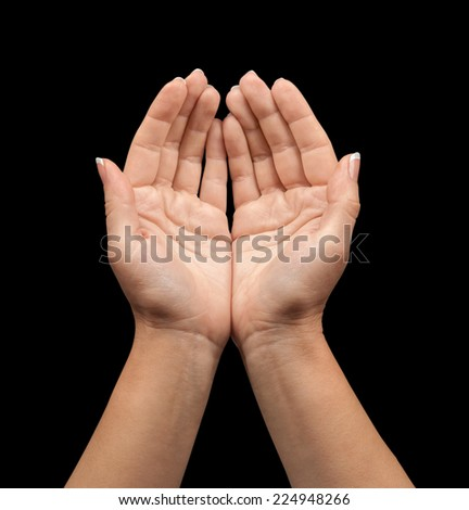 open hands on a black background isolation - stock photo