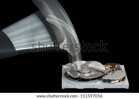 Open Hard Disk Drive Being Destroyed with a Hammer on a black background - stock photo