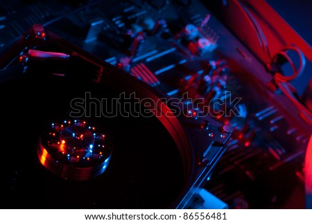 Open hard drive on a circuit board - stock photo
