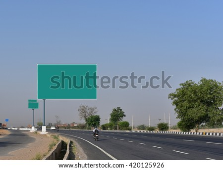 Open Highway road with empty sign board for advertisement messages
