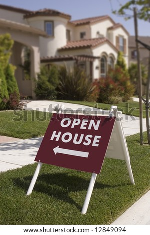 Open house sign, indicating new home to  look at, sign is sharp focus falls off in the background