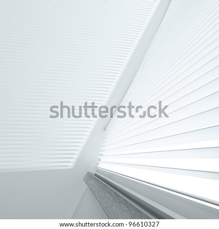 Open jalousie and shade on a wall from light from a window - stock photo