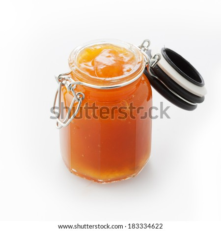 Open jar of fruit marmalade on white background. - stock photo
