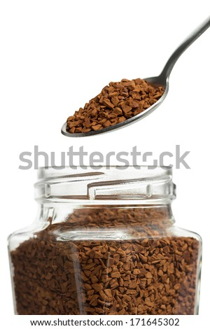 Open jar with instant coffee and a spoon - stock photo