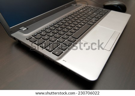 Open laptop computer on wooden table. selective focus image - stock photo