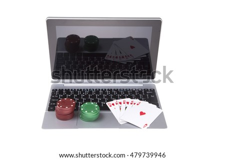 Open laptop facing camera with poker chips and cards on keyboard