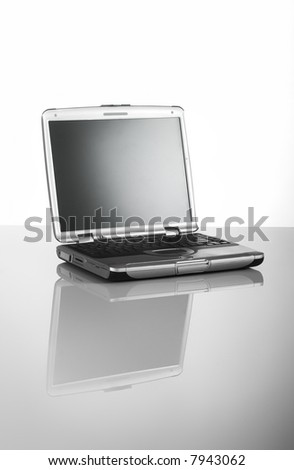 Open Laptop on a desk with relfection - stock photo