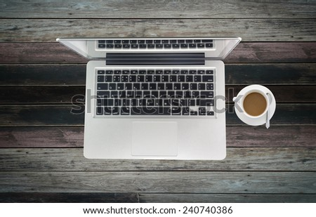 Open laptop on old wooden desk - stock photo