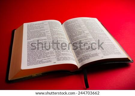 Open leather King James Bible religious symbol - stock photo