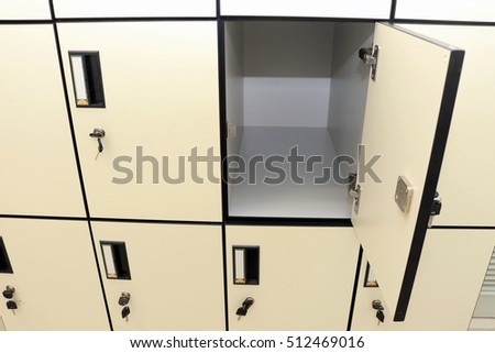 Open Lockers Cabinets Furniture In A Locker Room At School Or University  For Student.