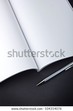 Open magazine with pen - stock photo