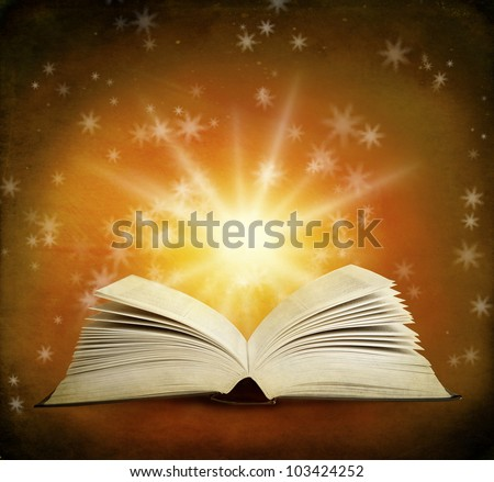 Open magic book on a background and lights - stock photo