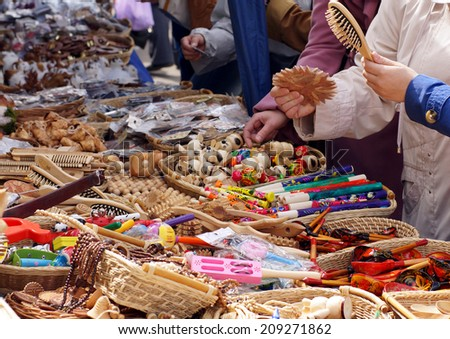 Open market. Buyers looking at souvenirs on the market. - stock photo