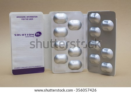 Open medicine packet labell Solution 20 mg opened at one end to display a blister pack of tablets - stock photo