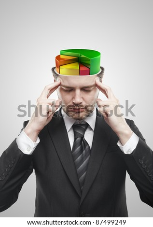 Open minded man with colorful 3d pie chart graph inside. Conceptual image of a open minded man. On a gray background - stock photo