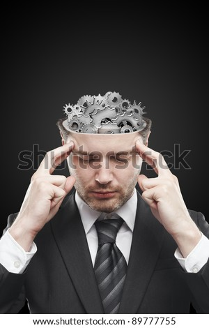 Open minded man with gears and cogs inside showing brain activity. Conceptual image of a open minded man - stock photo