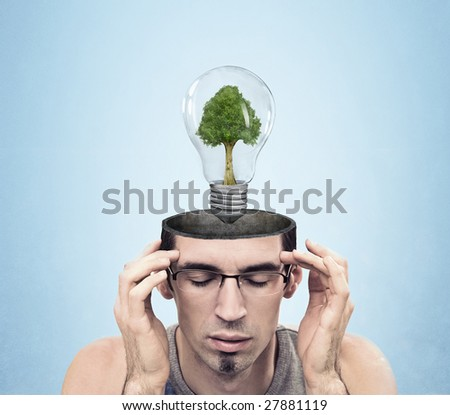 Open minded man with green energy symbol - stock photo