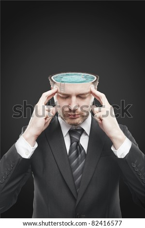 Open minded man with swimming pool inside thinking about relax.Conceptual image of a open minded man. - stock photo