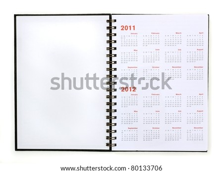 open note book with calendar 2011, 2012 - stock photo