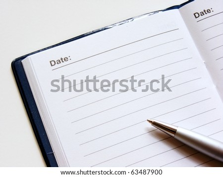 Open note book with lined pages free date space and ballpoint pen - stock photo