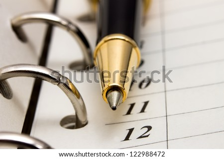 Open notebook and ballpoint pen, selected focus - stock photo
