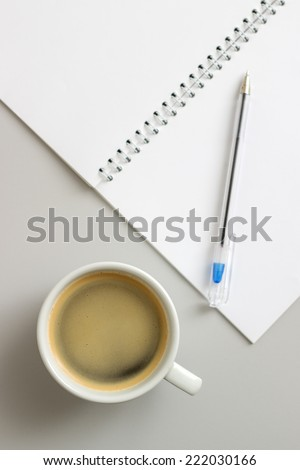 open notebook and cup of coffee, from above - stock photo