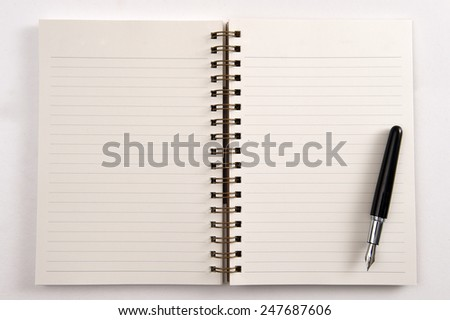 Open notebook and pen isolated on white background