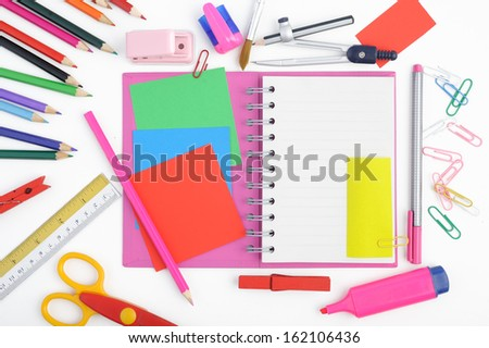 Open notebook and school or office tools on white background  - stock photo