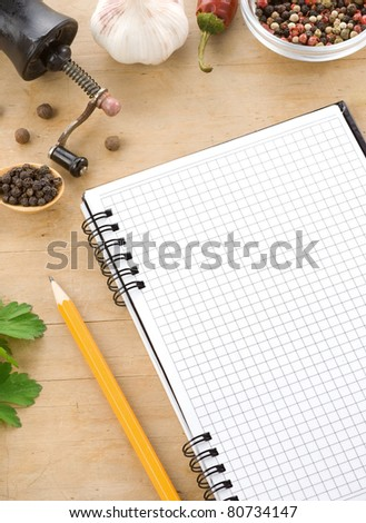 open notebook cookbook ready for recipe and spices - stock photo