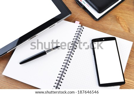 open notebook, mobile  phone and black  pen on white background - stock photo