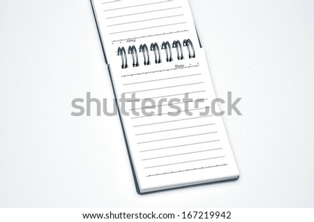 Open notebook on a white background close-up. - stock photo