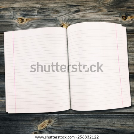 Open Notebook On The Wooden Background - stock photo