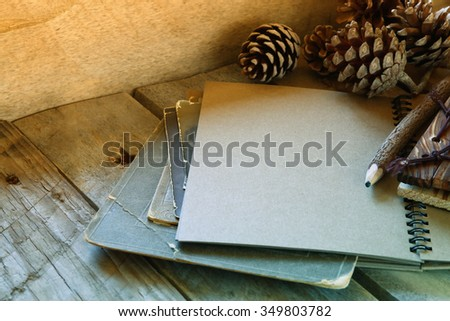open notebook on wooden table. retro filtered and toned image  - stock photo