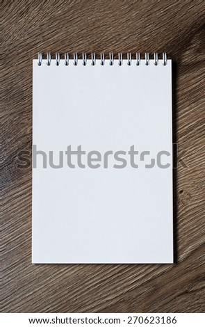 Open notebook with blank empty pages
