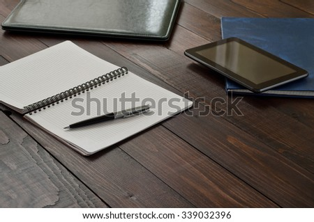 Open notebook with blank pages with a pen on the office wooden table. Top view.  Close up - stock photo
