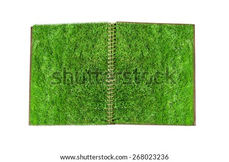Open notebook with green grass page.  Ecology concept - stock photo
