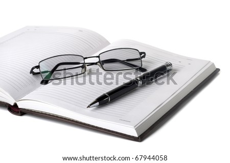 Open notebook with pen and glasses on a white background - stock photo