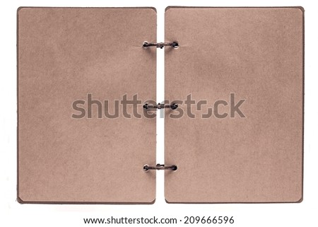 open notebook with sheets of pages from paper of brown color and binder rusty metal rings on a white background - stock photo