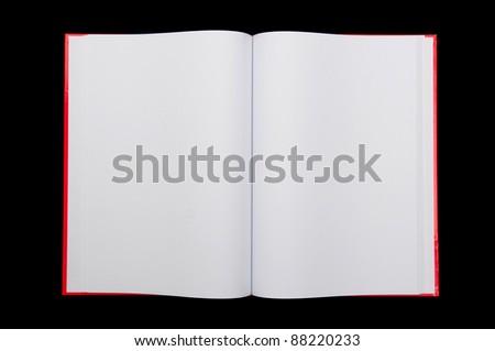 Open notepad on black background - stock photo